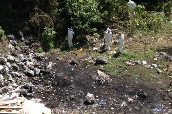 Peritos argentinos identifican 3 cuerpos en fosas de Guerrero (11:35 h)